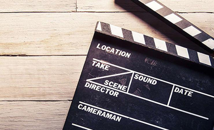 Film clapperboard lying down for movie convention