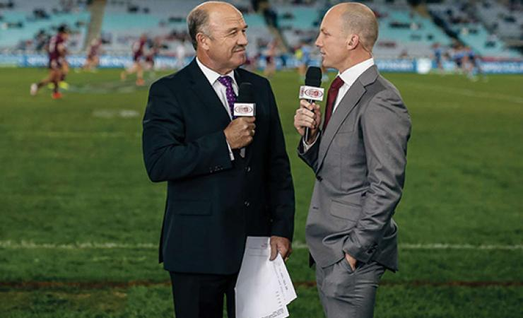 Wally Lewis and Darren Lockyer standing on a rugby league field