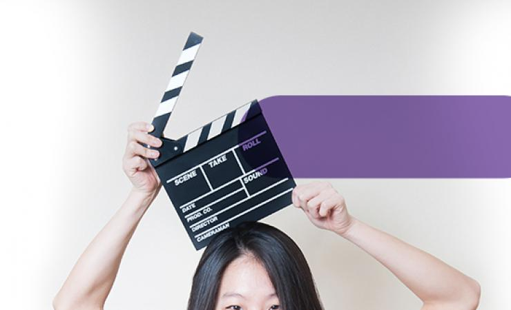 Woman holding movie clapperboard