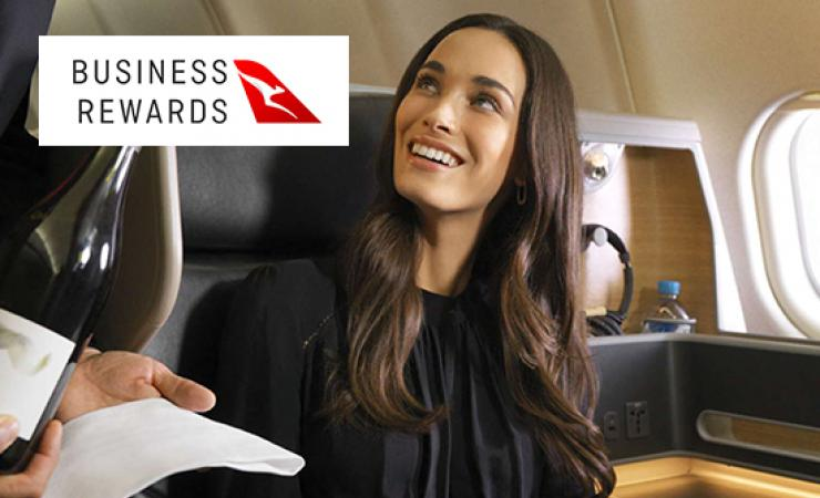 Woman on Qantas flight being served wine