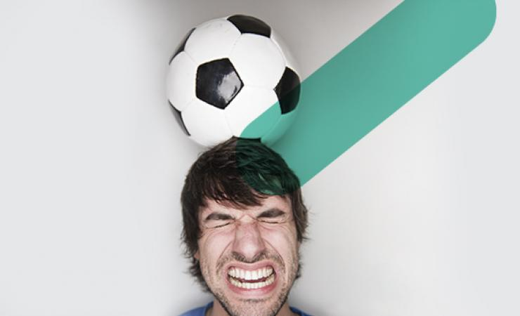 Man head-butting soccer ball