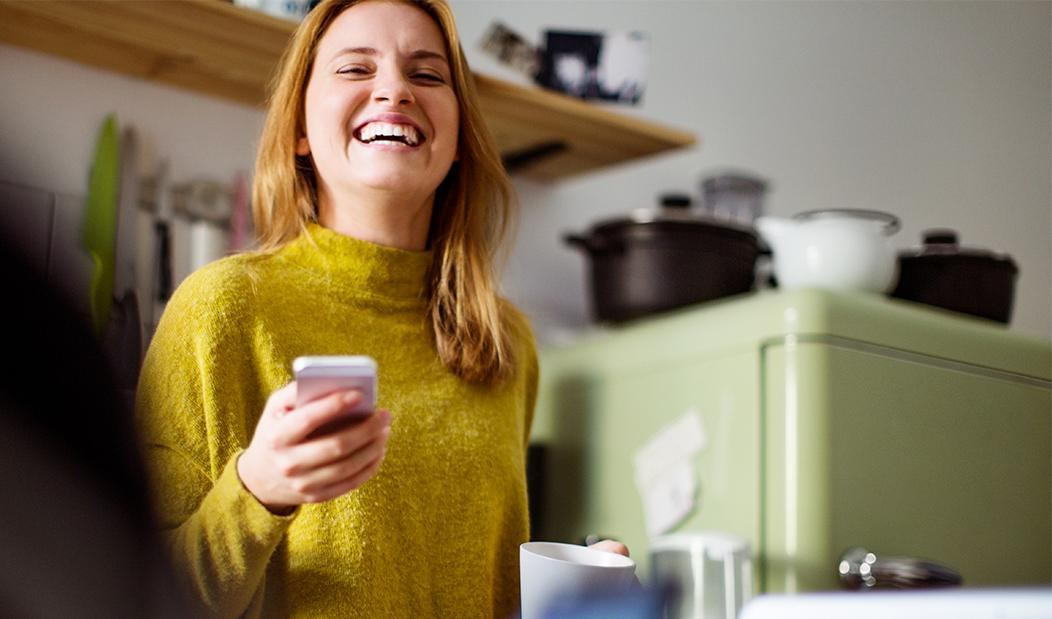 Lady smiling with phone