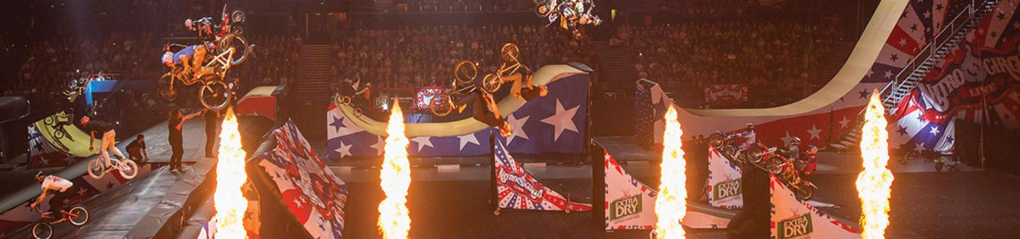 Landscape shot of Nitro Circus with flames